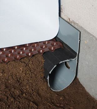 Closeup of a crawl space drainage system installed in Cactus