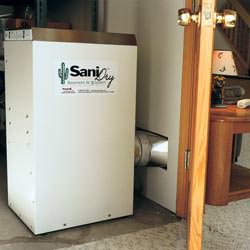 A basement dehumidifier with an ENERGY STAR® rating ducting dry air into a finished area of the basement  in Shamrock
