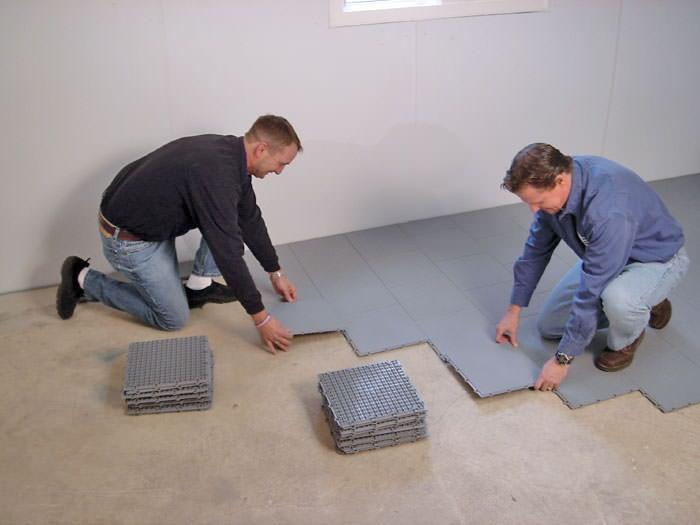 Contractors Installing Bat Subfloor Tileatting On A Concrete Floor In Dumas Texas